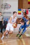 FIBA EuroChallenge :: BC Mures vs Tsmoki Minsk. Goran Martinic drives the ball against Parrish Petty in the FIBA Eurochallenge game between BC Mures and Tsmoki Royalty Free Stock Photo