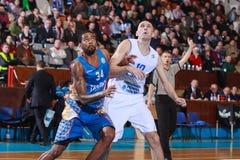 FIBA EuroChallenge :: BC Mures vs Tsmoki Minsk. Keith Benson (left) battles Ivan Ivanovic (right) for the rebound in the FIBA Eurochallenge game between BC Mures Stock Images
