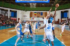 FIBA EuroChallenge :: BC Mures vs Tsmoki Minsk. Keith Benson tries to score 2 points against Aleksandar Mladenovic and Denham Brown in the FIBA Eurochallenge Stock Image