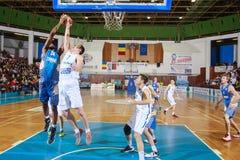 FIBA EuroChallenge :: BC Mures vs Tsmoki Minsk. Keith Benson tries to score 2 points against Aleksandar Mladenovic in the FIBA Eurochallenge game between BC Stock Images