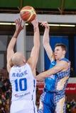 FIBA EuroChallenge :: BC Mures vs Tsmoki Minsk. Pavel Ulyanko tries to score 2 points against Ivan Ivanovic in the FIBA Eurochallenge game between BC Mures and Royalty Free Stock Photo
