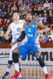 FIBA EuroChallenge :: BC Mures vs Tsmoki Minsk. Tudor Jucan (left) battles Vincent Hunter (right) for a rebound  in the FIBA Eurochallenge game between BC Mures Stock Photo