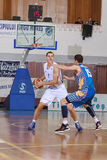 FIBA EuroChallenge :: BC Mures vs Tsmoki Minsk. Vaidotas Peciukas is defended by Aliaksei Trastsinetski  in the FIBA Eurochallenge game between BC Mures and Stock Photography