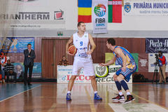 FIBA EuroChallenge :: BC Mures vs Tsmoki Minsk. Vaidotas Peciukas is defended by Aliaksei Trastsinetski  in the FIBA Eurochallenge game between BC Mures and Royalty Free Stock Photos