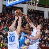 FIBA EuroChallenge :: BC Mures vs Tsmoki Minsk. Vincent Harper tries to score 2 points against Ivan Ivanovic (left) and Aleksandar Mladenovic (right) in the FIBA Stock Image
