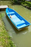 Fiber Blue boat in canal royalty free stock photo