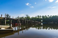 Fiber boat and wooden bridge at sunny day Stock Images