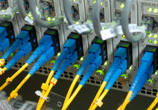 Fiber cables. Connected to servers in a datacenter Stock Photography