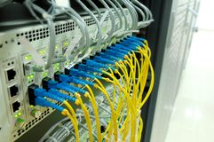 Fiber cables. Connected to servers in a datacenter Royalty Free Stock Photography