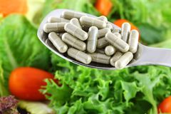 Fiber Capsules OR Fresh Salad Royalty Free Stock Image