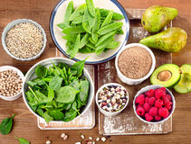 Fiber and carbs rich foods on a wooden board. Healthy diet eatin. G. Top view Stock Photo