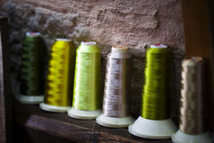 Fiber Cotton Fabric Textile Roller on bobbin and light ropes Yarn Royalty Free Stock Photos