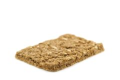 Fiber Crispbread. A crispbread with high content of dietary fiber on white background. Dietary fiber / roughage is not a digestible carbohydrate royalty free stock photography