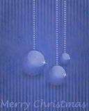 Fiber fabric and glitter film and christmas balls, christmas card. Grey fiber fabric and blue glitter film and christmas balls and the words Merry Christmas Royalty Free Stock Images