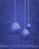 Fiber fabric and glitter film and christmas balls, christmas card. Grey fiber fabric and blue glitter film and christmas balls and the words Merry Christmas Stock Photography