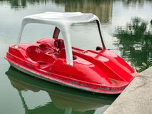 Fiber glass boat in the park. At thailand Royalty Free Stock Image