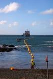 Fiber - kommande optisk kabel ashore royaltyfri fotografi