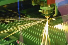 The fiber laser cutting machine controller by CNC program. The sheet metal cutting process by CNC fiber laser cutting royalty free stock image