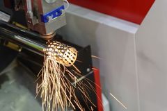 The fiber laser cutting machine cutting the steel pipe. With the sparking light royalty free stock image