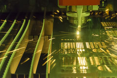 The fiber laser cutting machine. Cutting the sheet metal with the sparking light Stock Photo