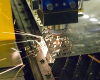Fiber laser machines for metal cutting close-up. A laser beam cuts the sheet metal in the manufacture. Industrial technologies, production processes Stock Photos