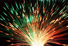 Fiber light in green and red. On black Stock Photography