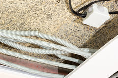 Fiber mat and suspended ceilings and electrical wiring Stock Photos