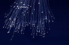 Fiber Optic. Emitting light over a blue dark background Stock Image