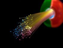 Fiber Optic Bundle. Bundle of optical fibers lit by multi-coloured lights (in a children's toy).  isolated on black; selective focus Stock Image