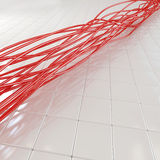 Fiber optic cable. Red fiber optical cable over white tiled background Stock Photo