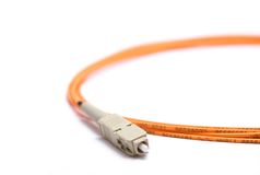 Fiber optic cable. A Fiber optic cable with connector Stock Photos