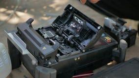Fiber optic cable splice machine closeup. Fiber Splicing Tool Machine in use for connecting fiber optic cable stock video