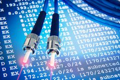 Fiber optic cables for backbone lines on blue network background. IP addresses and masks on the background Stock Photo
