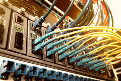 Fiber Optic cables connected to an optic ports and cable Royalty Free Stock Images