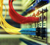 Fiber Optic cables connected to an optic ports and cable Stock Photography