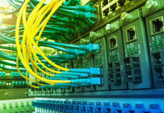 Fiber Optic cables connected to an optic ports Royalty Free Stock Images