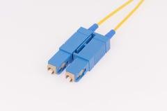 Fiber optic cables on grey background. Fiber optic cables isolated on grey background Royalty Free Stock Photo