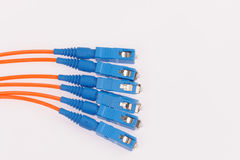 Fiber optic cables on grey background Royalty Free Stock Photography