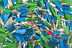 Fiber optic connectors. Closeup of various types of fiber optic connectors for background Stock Photos