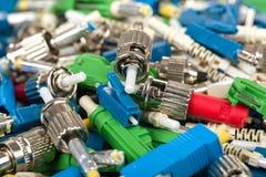 Fiber optic connectors. Closeup of various types of fiber optic connectors Royalty Free Stock Photography