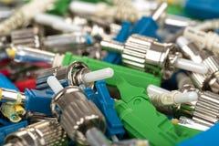 Fiber optic connectors. Closeup of various types of fiber optic connectors Royalty Free Stock Images