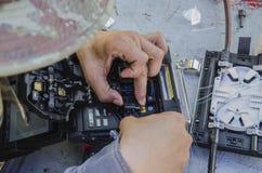 Fiber optic fusion splicer. Technicians are the fiber optic fusion splicer royalty free stock photo