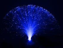 Fiber optic lamp. Blue fibre optic table lamp against a black background stock image
