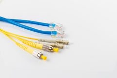 Fiber optic patchcord head and UTP LAN cable head Royalty Free Stock Photo