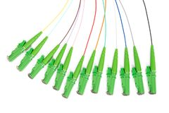 Fiber optic single mode hybrid patch cord. Single mode fan out patch cord jumper with green fiber optic connector isolated on white background royalty free stock photography