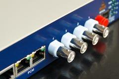 Fiber optic video converter. With optical FC connectors and video BNC connectors Stock Photos