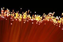 Fiber optics. In orange, red and yellow tones Royalty Free Stock Photo