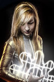 Fiber optics concept, future blonde dressed in silver Royalty Free Stock Photos