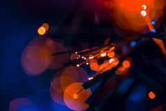 Fiber optics red blue lights bokeh. Communication technology background Royalty Free Stock Photos