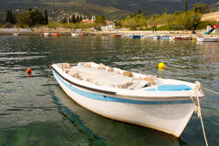 Fiberglass Boat Moored in Harbor Royalty Free Stock Photography